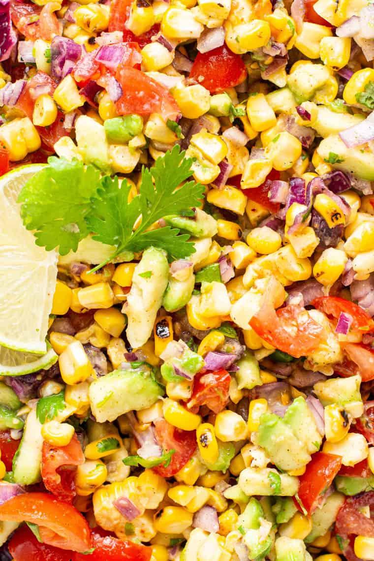 close up on corn, avocado and tomato salad