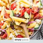 tomato and cucumber hummus pasta salad text overlay