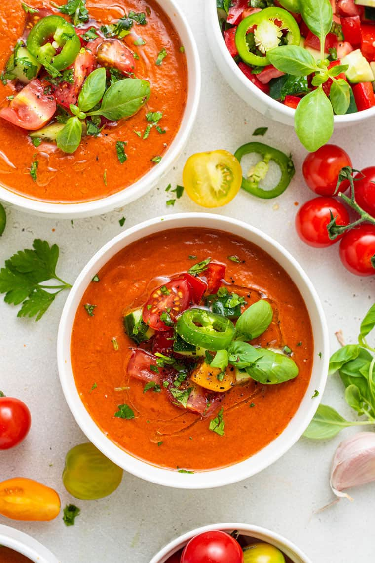 bowl of spicy tomato gazpacho with fresh veggies on top