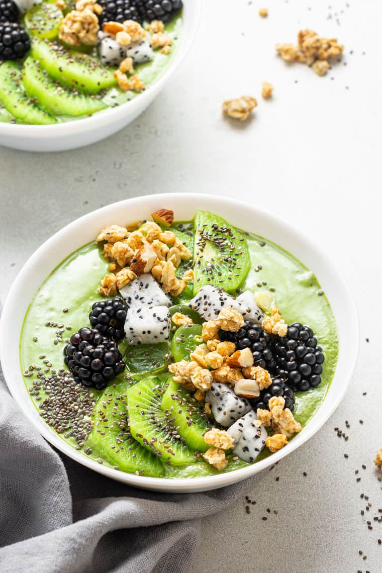 green smoothie bowl with chia seeds, kiwi and berries