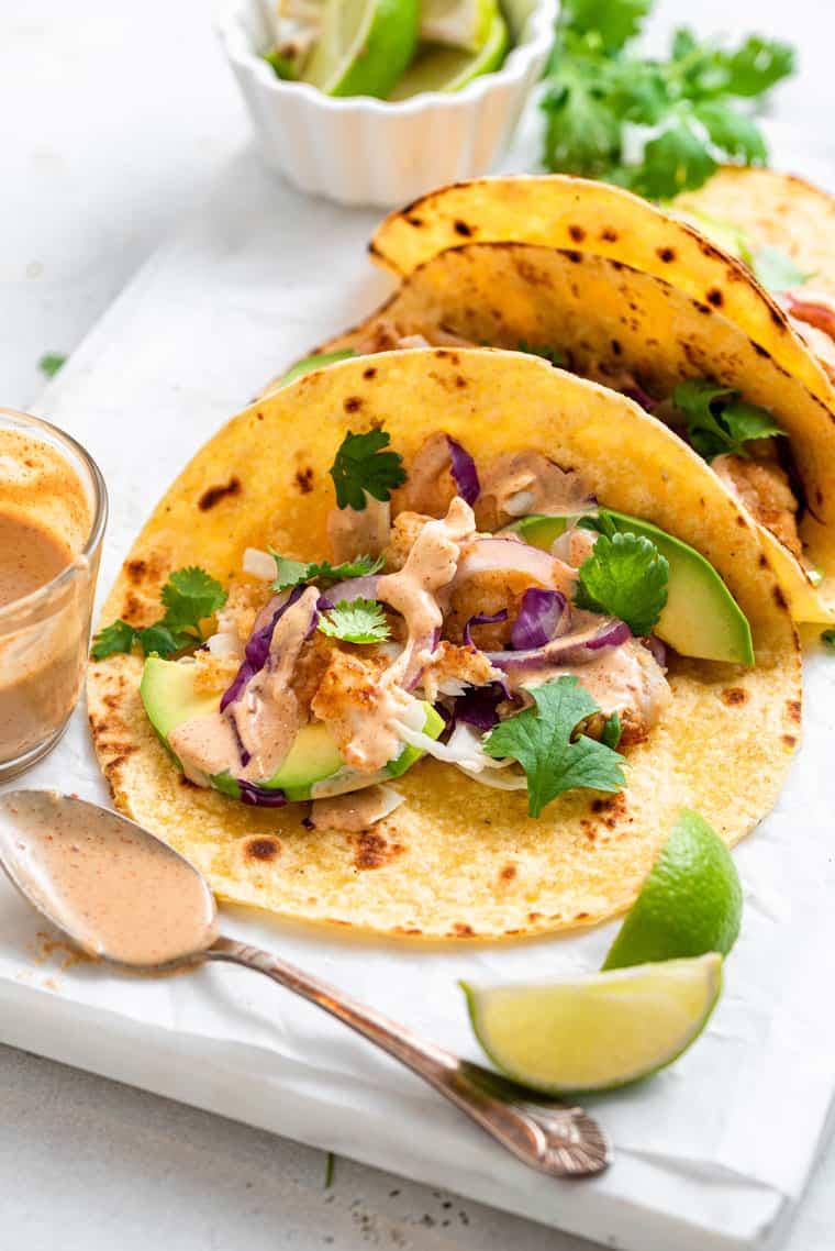 close up on a taco with crispy fish and tahini sauce