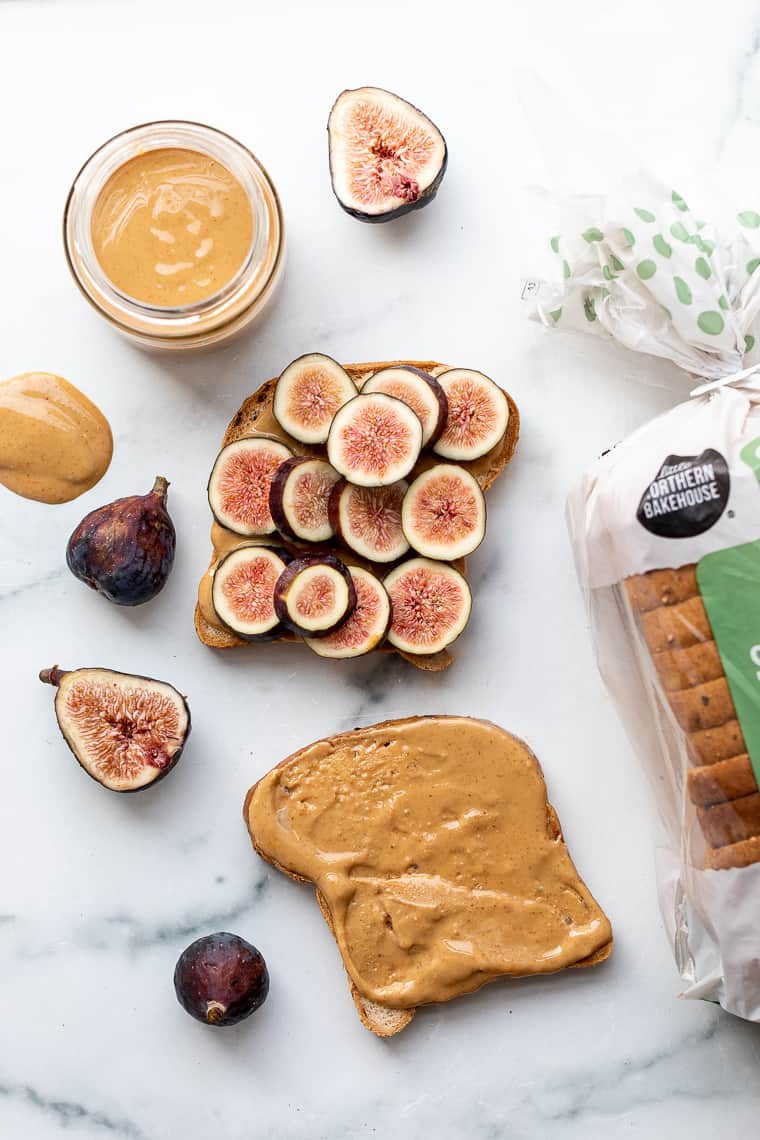 slices of bread with peanut butter and fresh fig slices