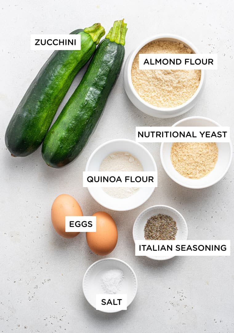 ingredients for pizza crust with zucchini, quinoa flour, almond flour, nutritional yeast and eggs