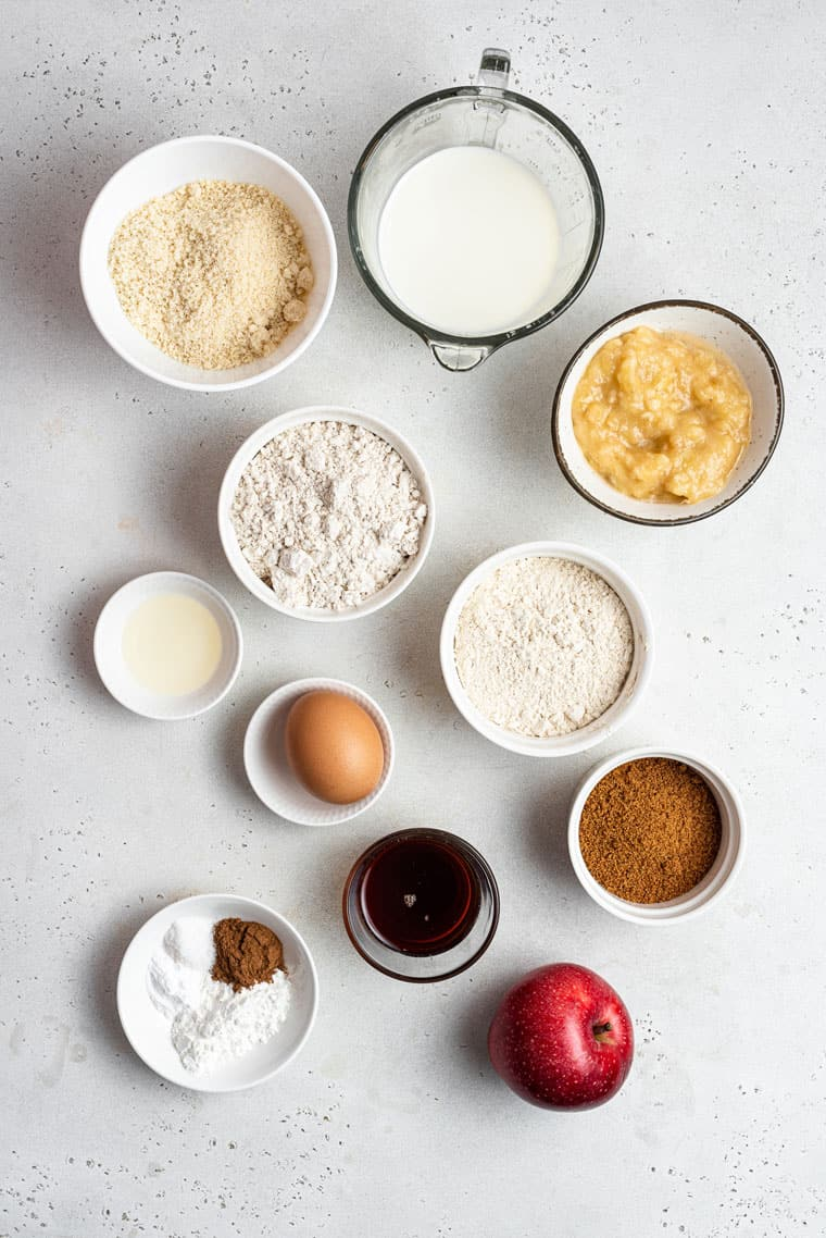 ingredients for muffins with apples, sugar, eggs, vanilla and flour