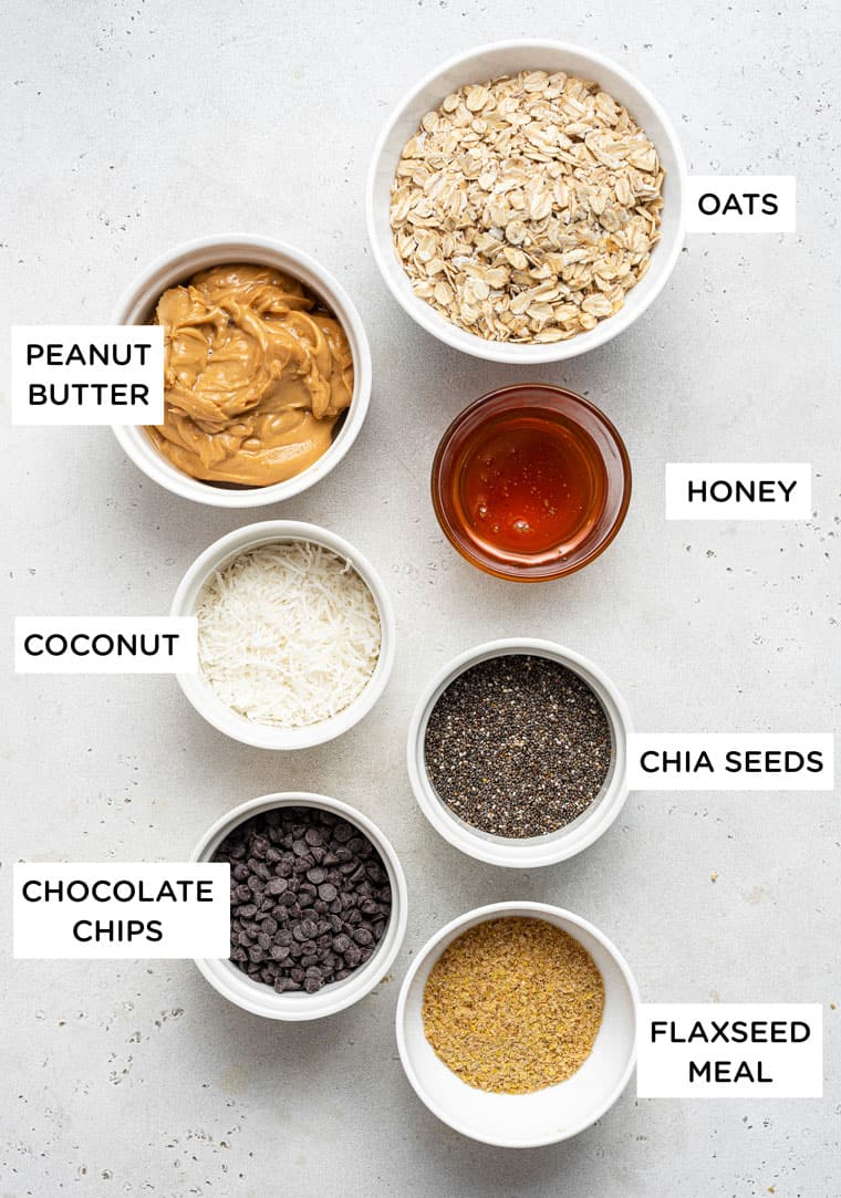 ingredients for energy bites with peanut butter, oats, coconut and chocolate