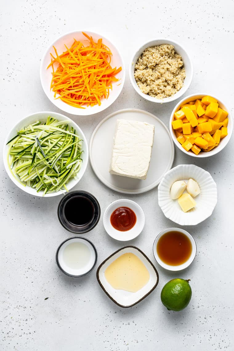 ingredients for bowls with quinoa, carrots, tofu and zucchini
