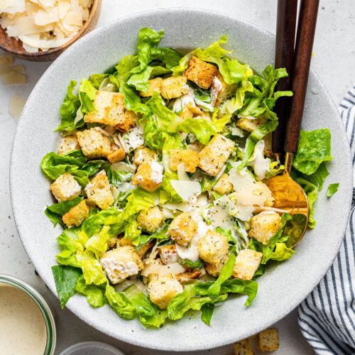 overhead of a bowlof vegan caesar salad with romaine and croutons