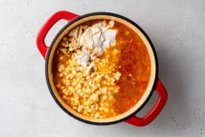 overhead of vegan corn chowder with whole corn, cashew cream and spices